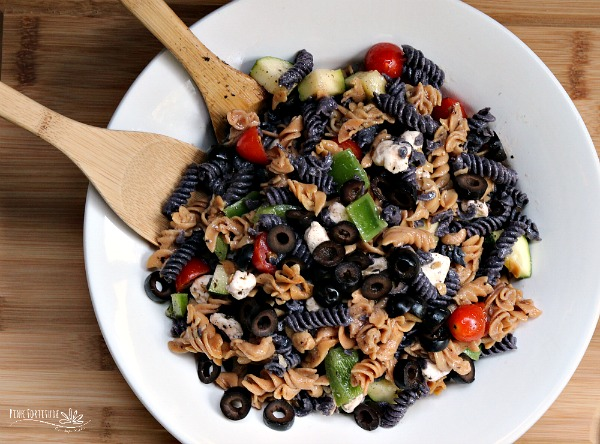 Sometimes, you need something quick and easy to whip up for your Halloween party. This Italian-style Halloween pasta salad is THE perfect dish to feed a crowd. Oh and BTW - it's made with whole foods and is gluten free and dairy free to accommodate anyone's nutritional protocols or dietary needs. AND - the black and purple pasta is made with all-natural ingredients. As in - real food. You don't have to be scared with this recipe... #halloween #recipe #pasta #pinkfortitude