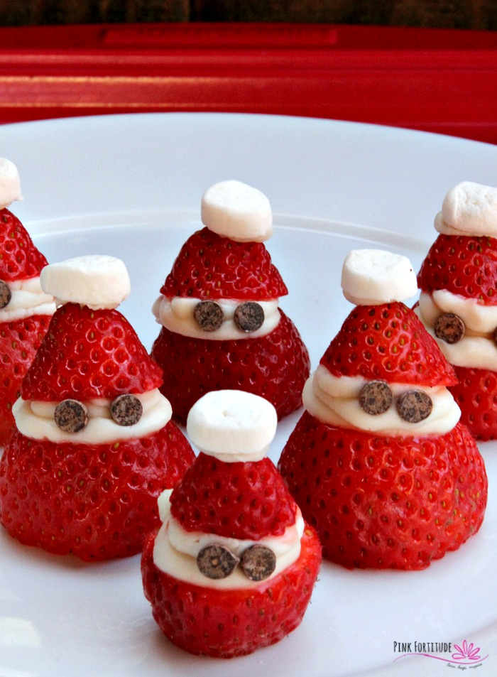 Sometimes at the holidays, you need to serve a treat for kids of all ages. These strawberry Santas are just that. They even have little strawberry Santa hats! They are made to be dairy free and vegan, and are naturally gluten free. It's a Christmas dessert and sweet treat for all! See how they are made... #christmas #strawberry #vegan #pinkfortitude