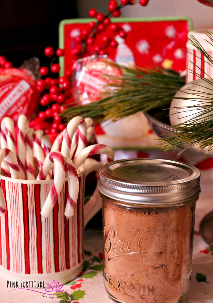 Is there anything better on a cold, winter day than to curl up by the fire with a cup of hot chocolate? This hot chocolate station is rustic and festive and is sure to warm your heart and spirit during the holidays and all winter long. #hotchocolate #pinkfortitude