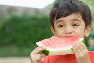 Indian boy eating watermelon Stock Photos - Page 1 : Masterfile