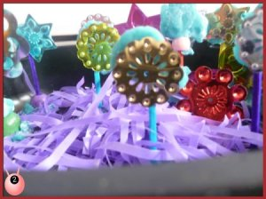 Pretend garden with flowers and purple grass