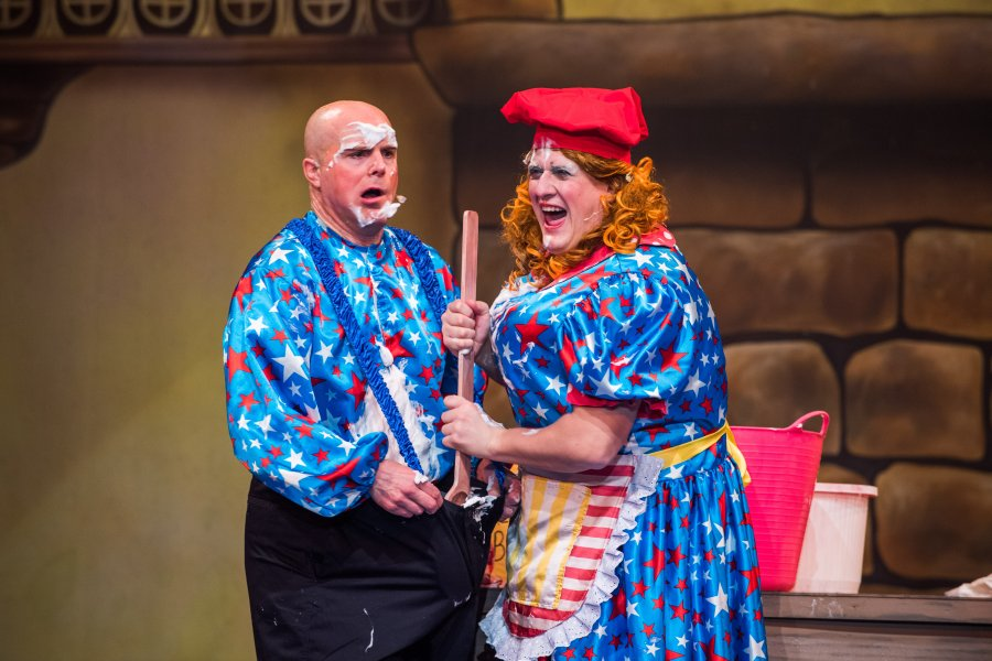 comedy panto scene with mess on his face and the dame