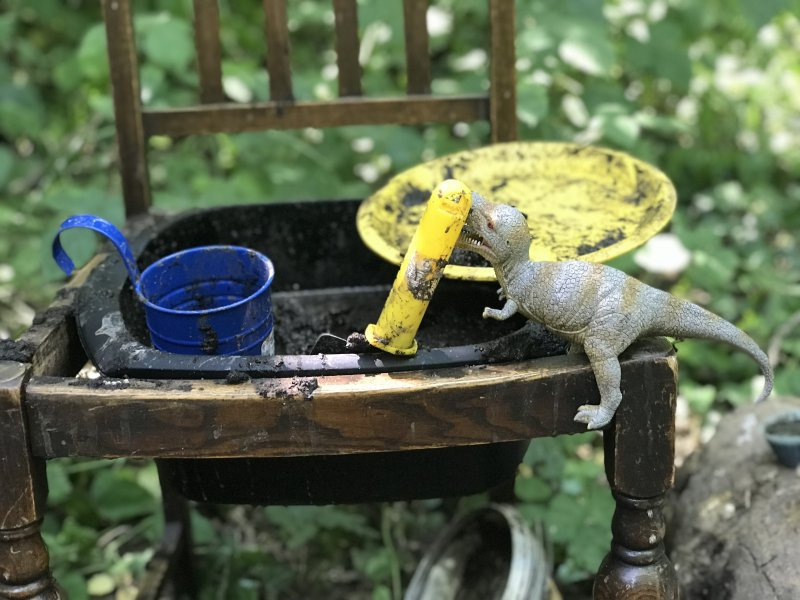 mud kitchen play with dinosaurs