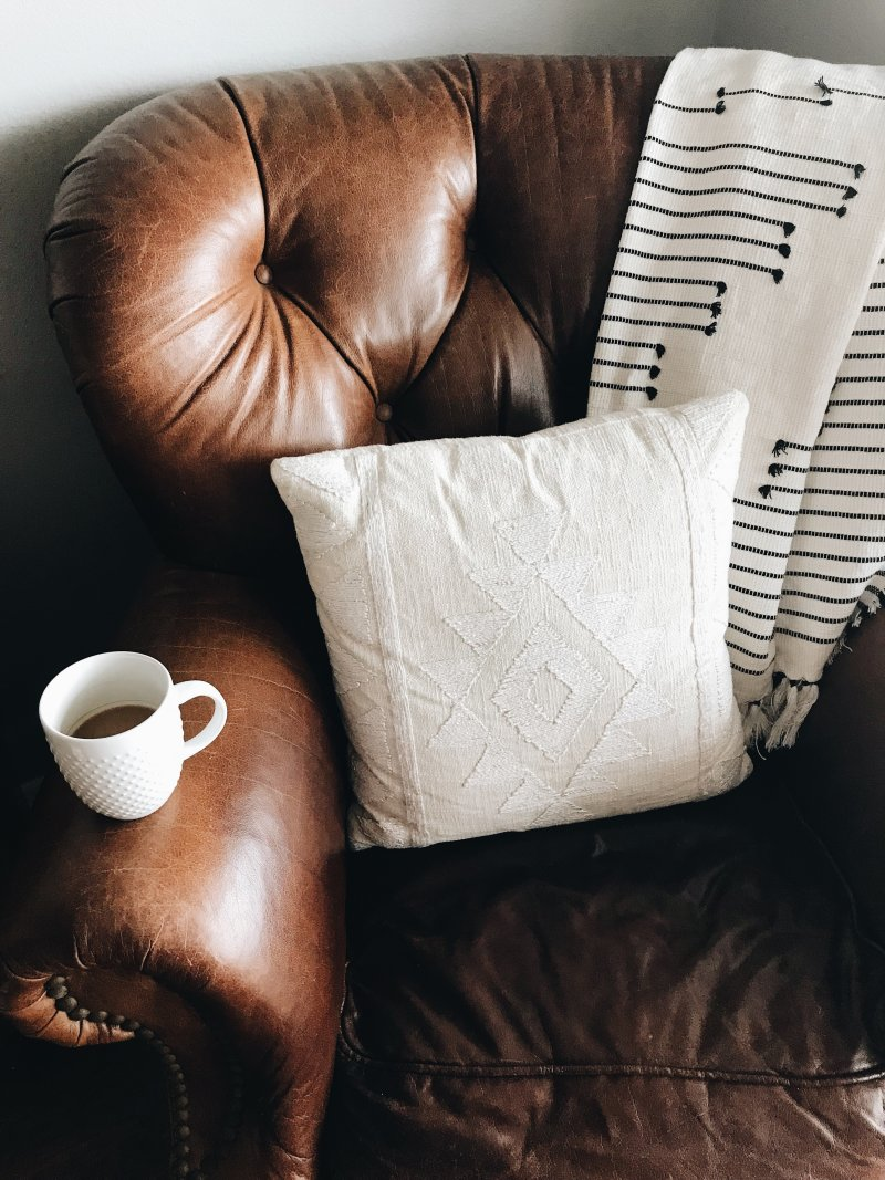 leather chair with cushion and drink