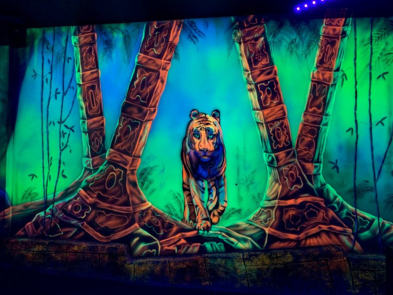 ultra violet wall of tiger coming between two trees