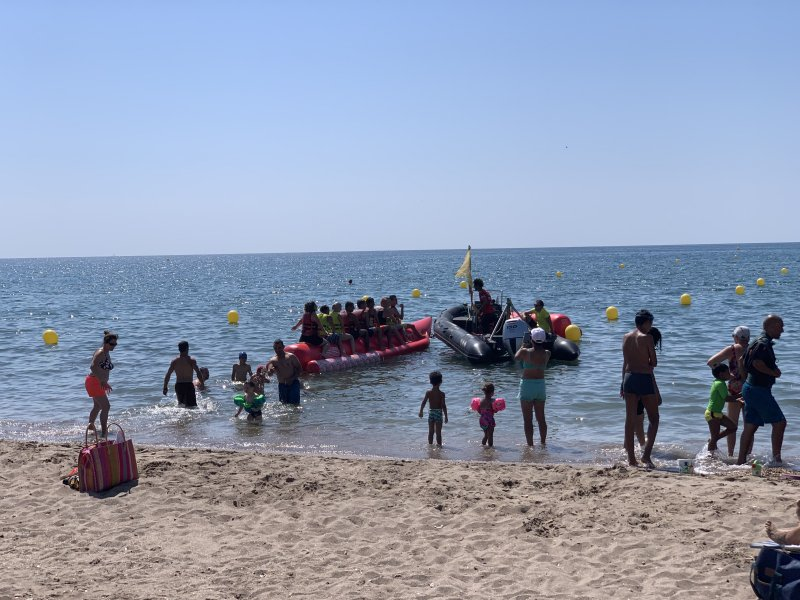 boat rides on the beach at Mediterranee Plage Camping Village