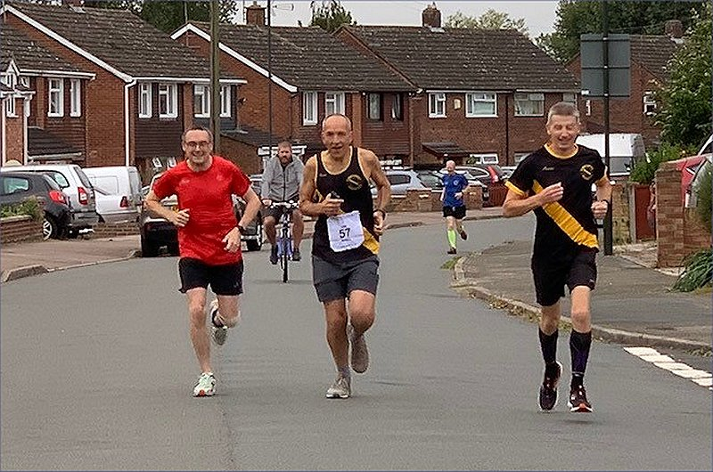 65 year old man running a split marathon with friends
