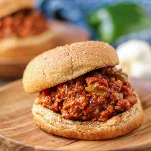 vegetarian sloppy joes on wooden plates with blue towel in background.