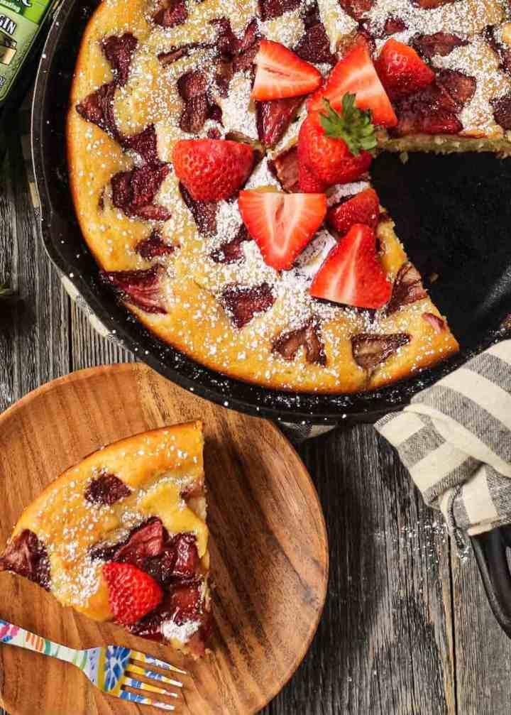 overhead shot of sliced roasted strawberry olive oil skillet cake