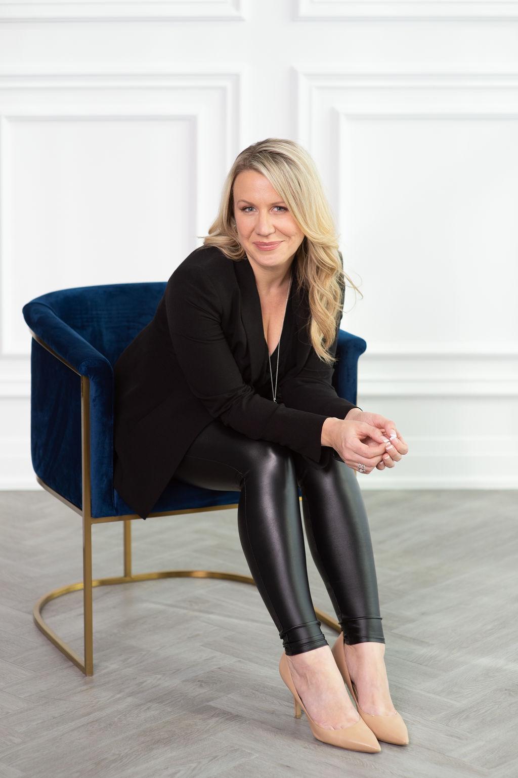 Jennifer sitting in a chair