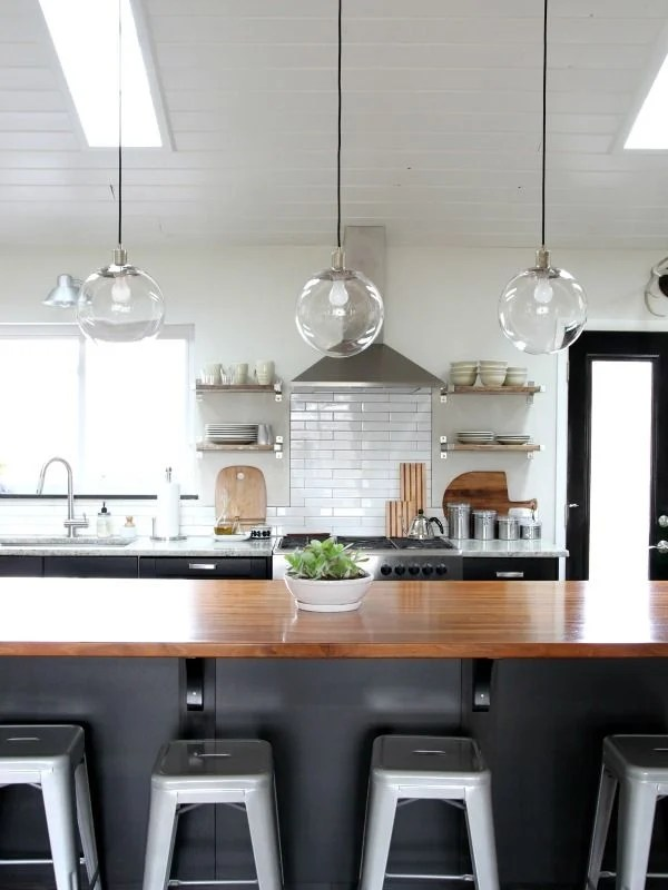 copper pendant lights over an island