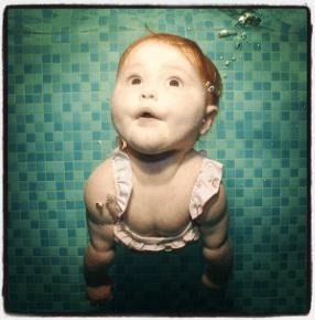 Ava swimming underwater