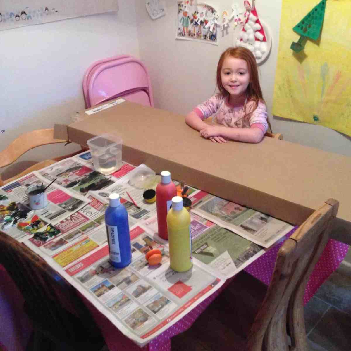 Ava getting ready to paint an IKEA box