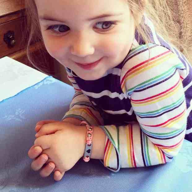 Thea wearing her Pink Pixie MyBugle ID Bracelet.jpg
