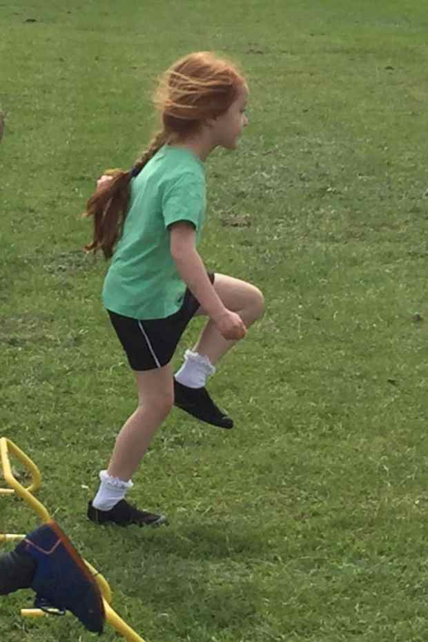 Ava doing the hurdles at Sports Day