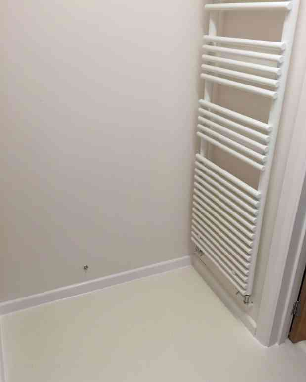 Utility room makeover with white radiator