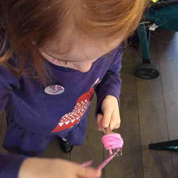 Making a pompom on a fork