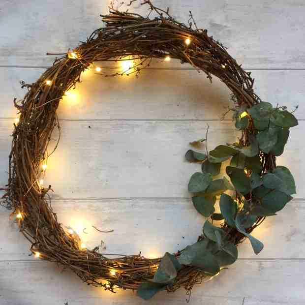 The first greenery on a simple Christmas wreath