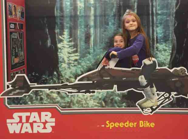 Ava and Thea on a Star Wars Speeder Bike