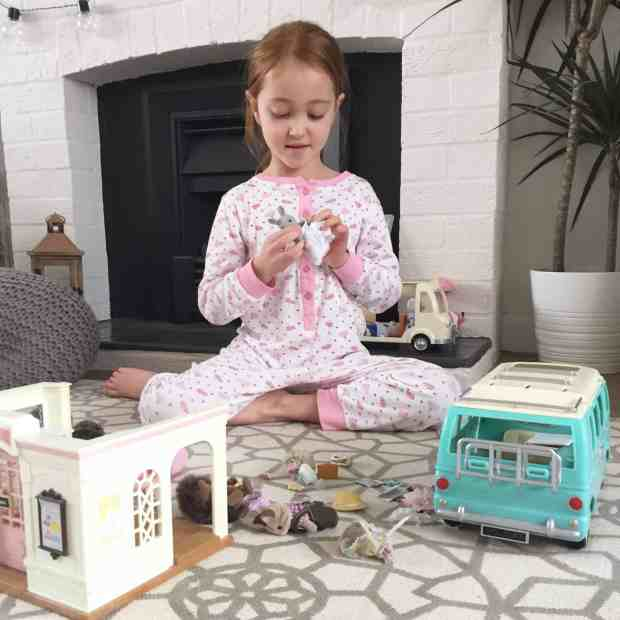 Ava playing with Sylvanian Families
