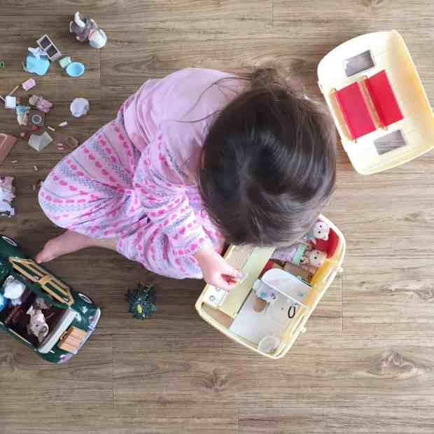 Thea playing with Sylvanian Families