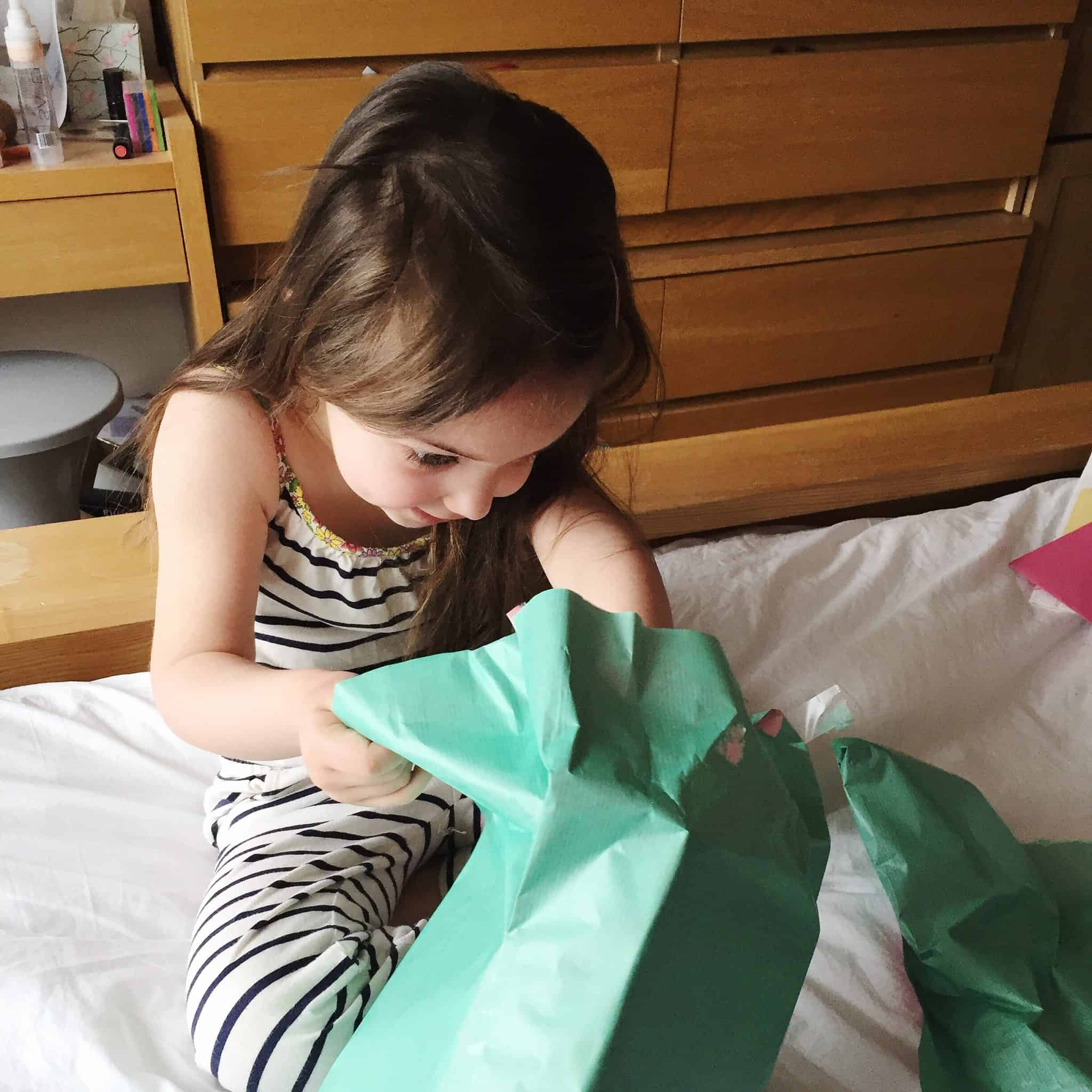 Thea on her 4th birthday opening presents