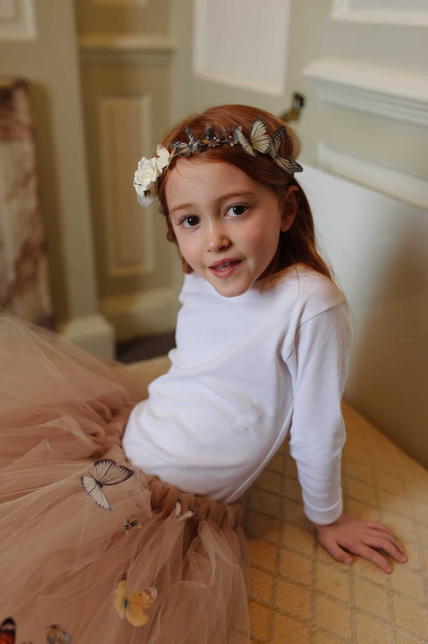 Ava in a Mimosa Bridal Butterfly Halo Headpiece