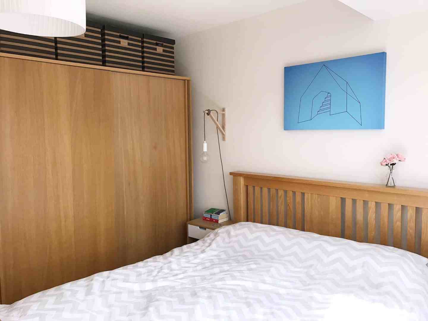 Laure wooden wardrobe and bed - miles away from a dream bedroom!