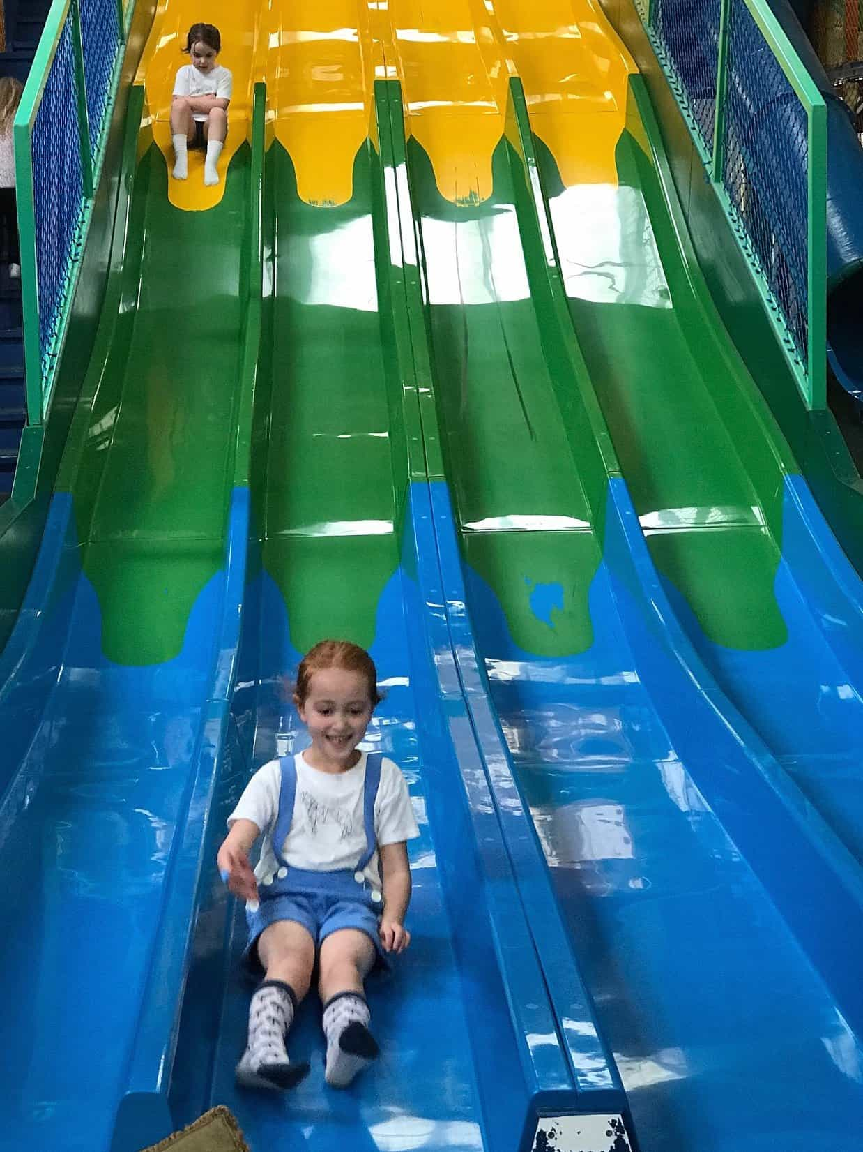 Thea and Ava on a giant slide