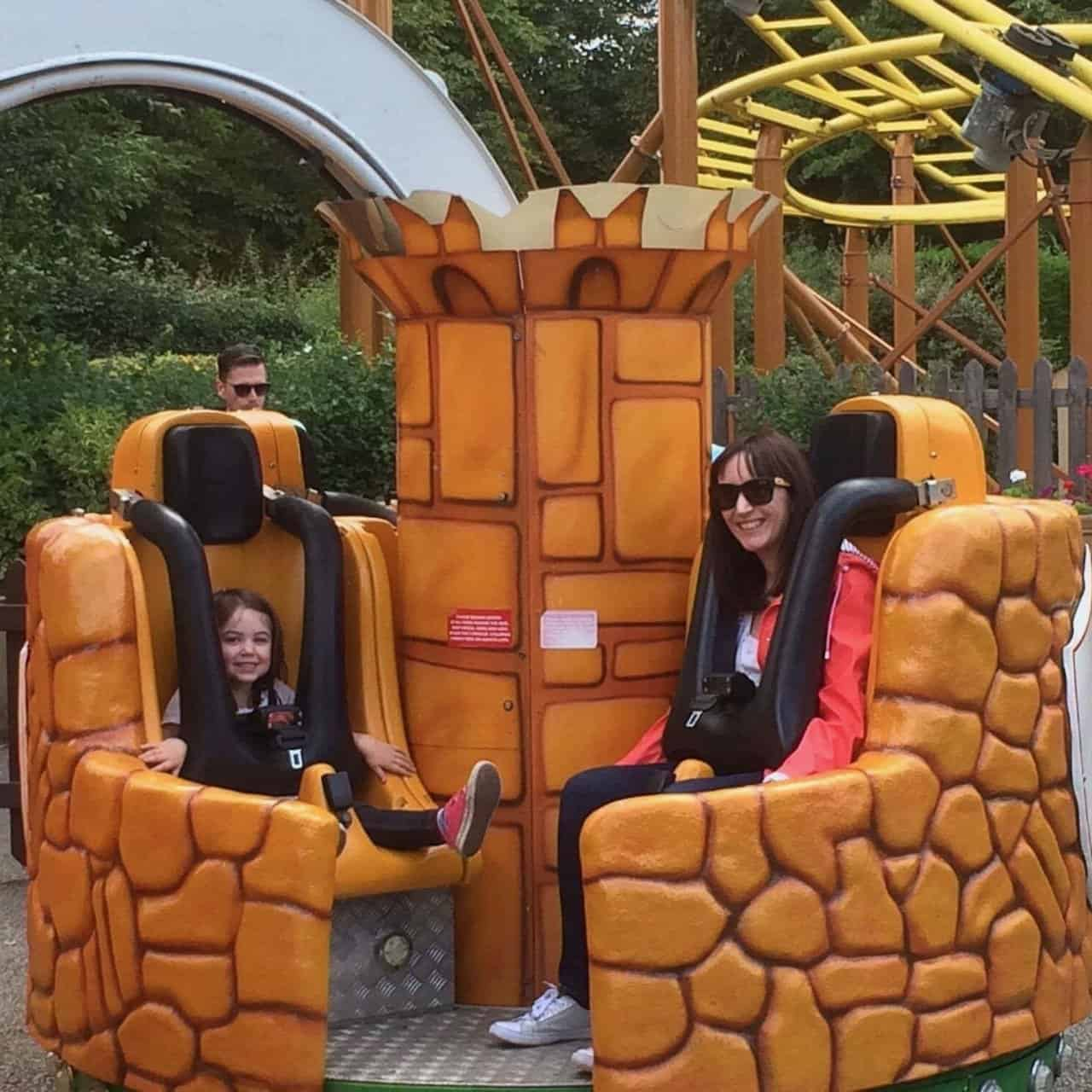 Thea and Becky on a ride at Gulliver's Land Theme Park Milton Keynes