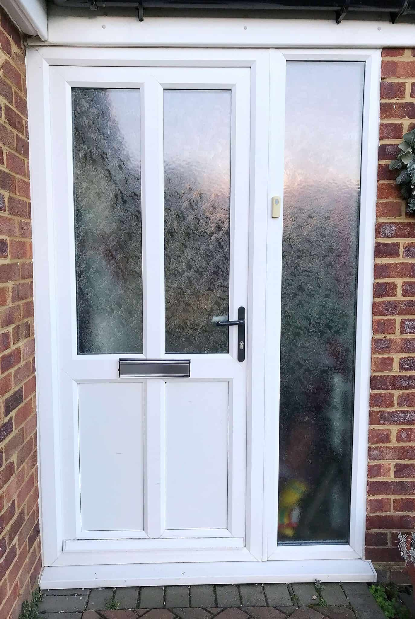 Old white pvc front door