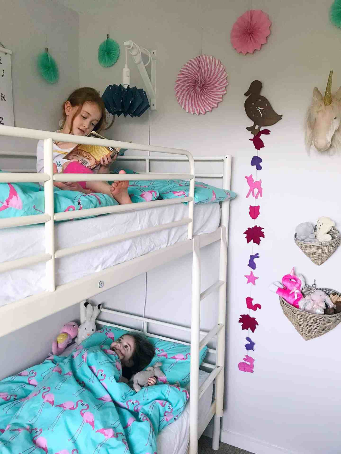 Sisters in their shared bedroom with bunk beds
