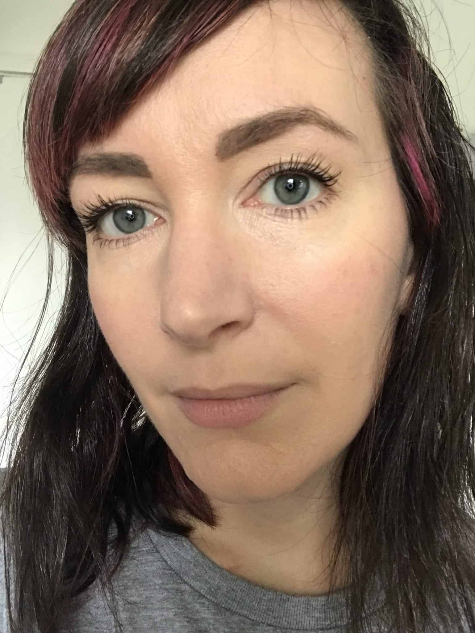 Wearing Nude by Nature concealer, powder foundation, finishing powder and mascara