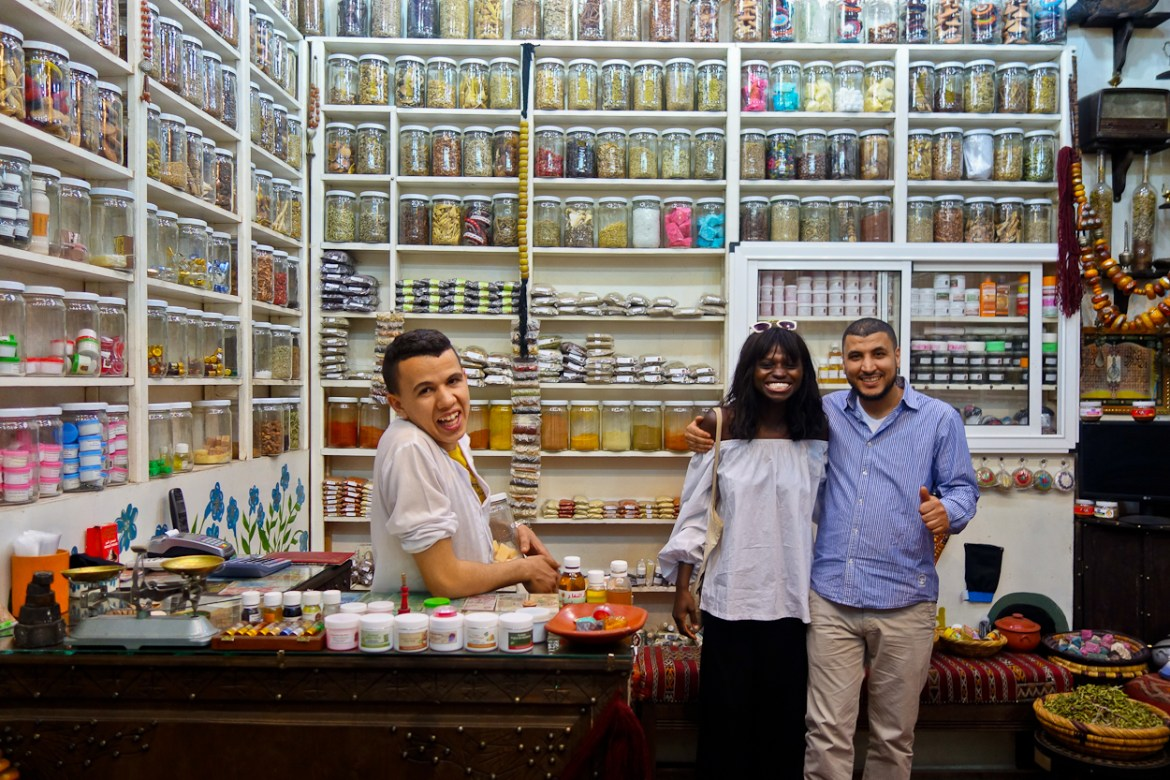 Amah making friends in an apothecary in the souk, Marrakech