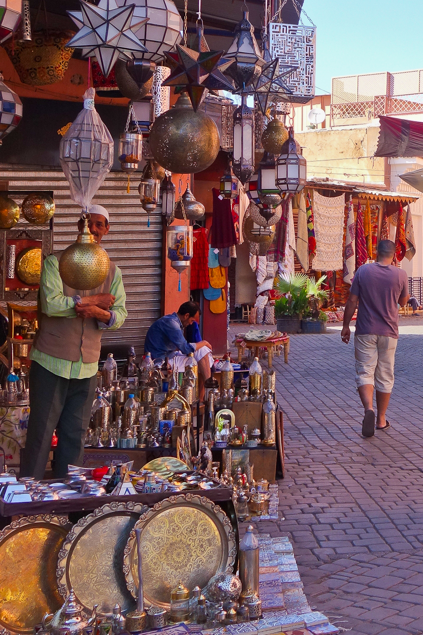 Shopkeeper with his wares in the souk, Marrakech