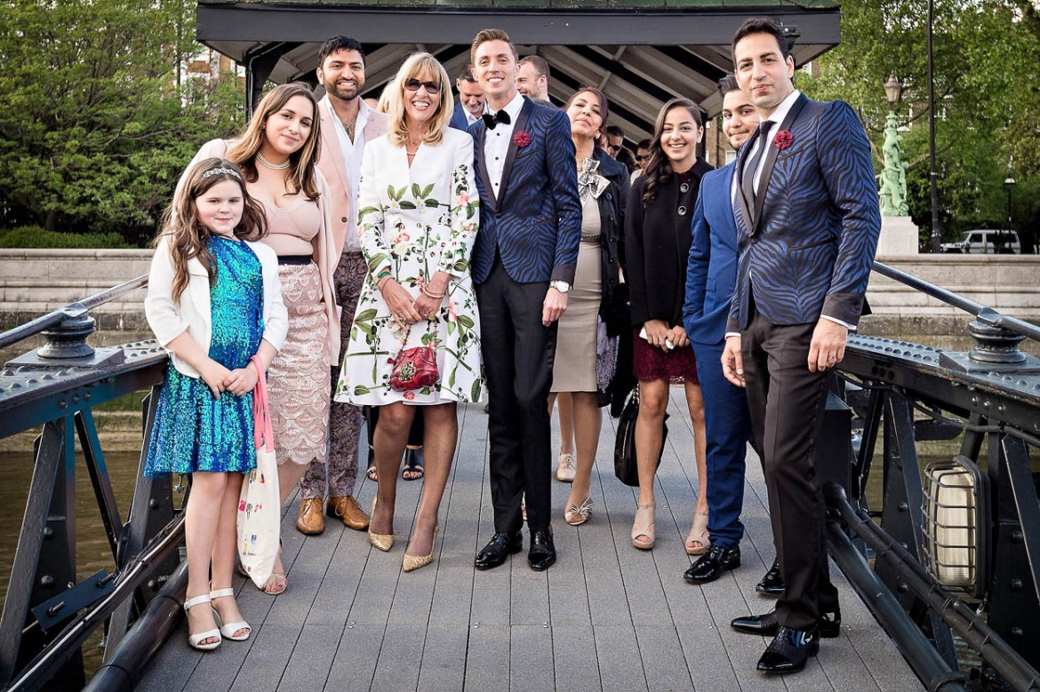 Antoine and Martin with wedding guests at Cadogan Pier, London