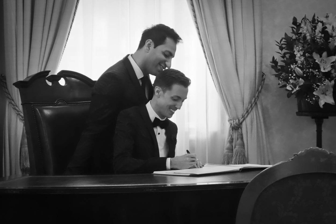 Antoine and Martin sign the register at their wedding in London