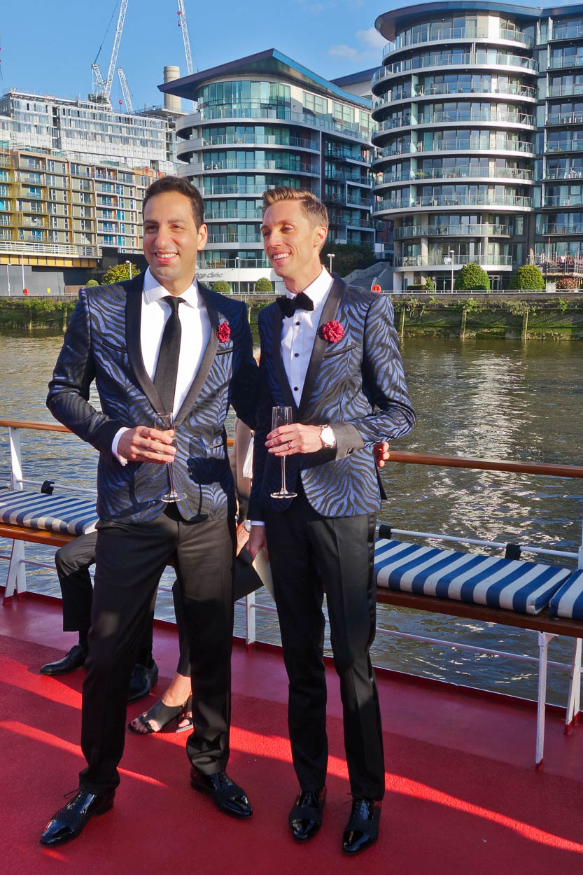Antoine and Martin pose for photos in front of their old apartment building at Chelsea Bridge Wharf, London