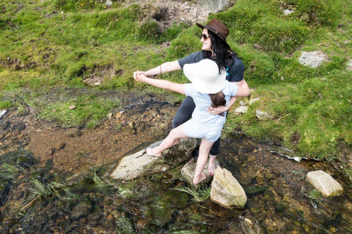 Laura and Miss France dancing on the stepping stones, Bodmin Moor, Cornwall
