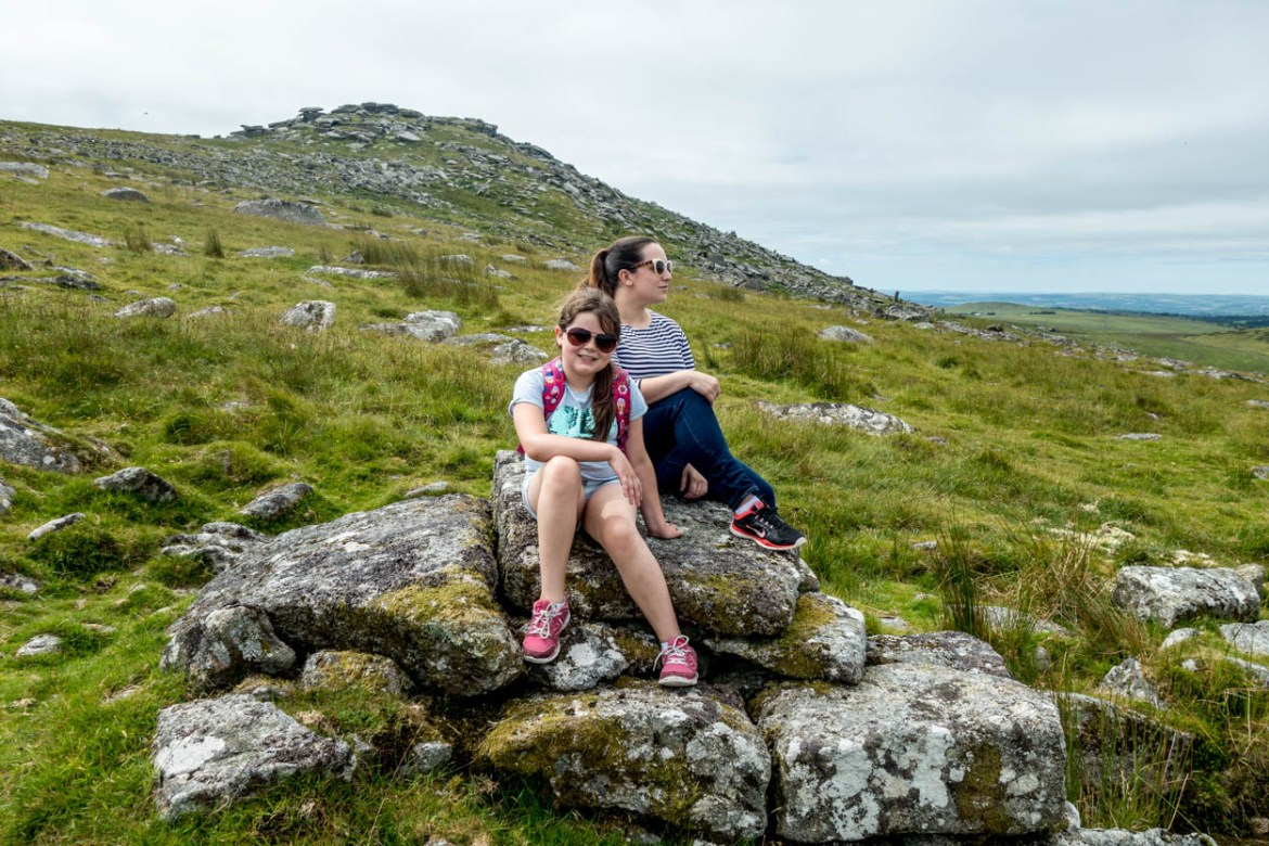 Miss France and pinkschmink enjoy the view with Rough Tor in the background on Bodmin Moor, Cornwall
