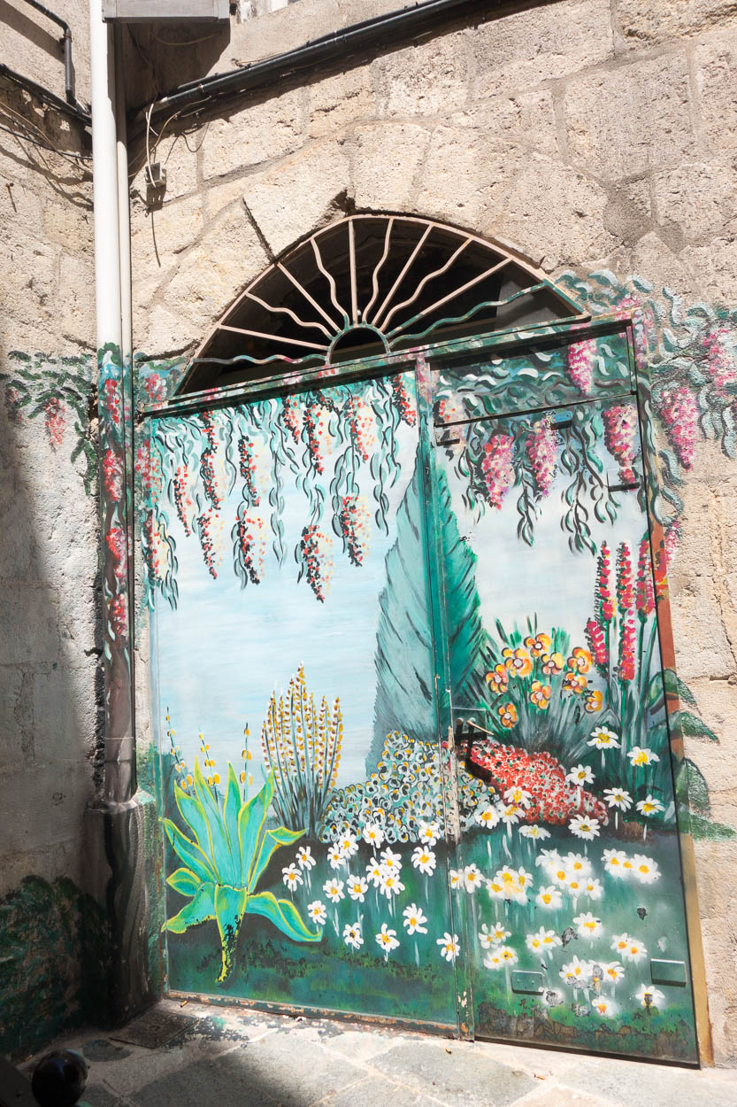 Painted mural on doors in Grasse
