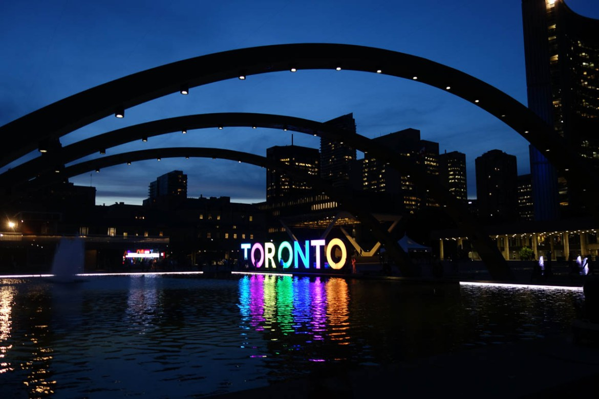 Toronto sign at night in Nathan Phillips Square