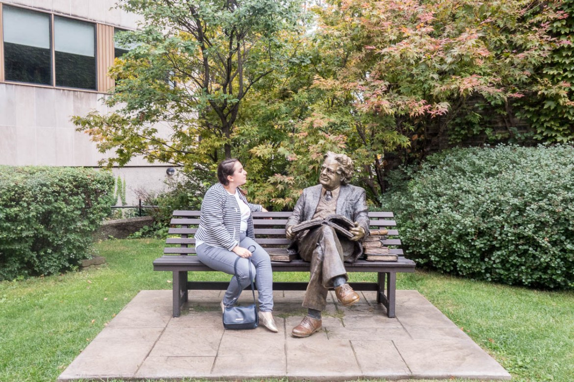 pinkschmink with the statue of eminent literary critic Northrop Frye, University of Toronto