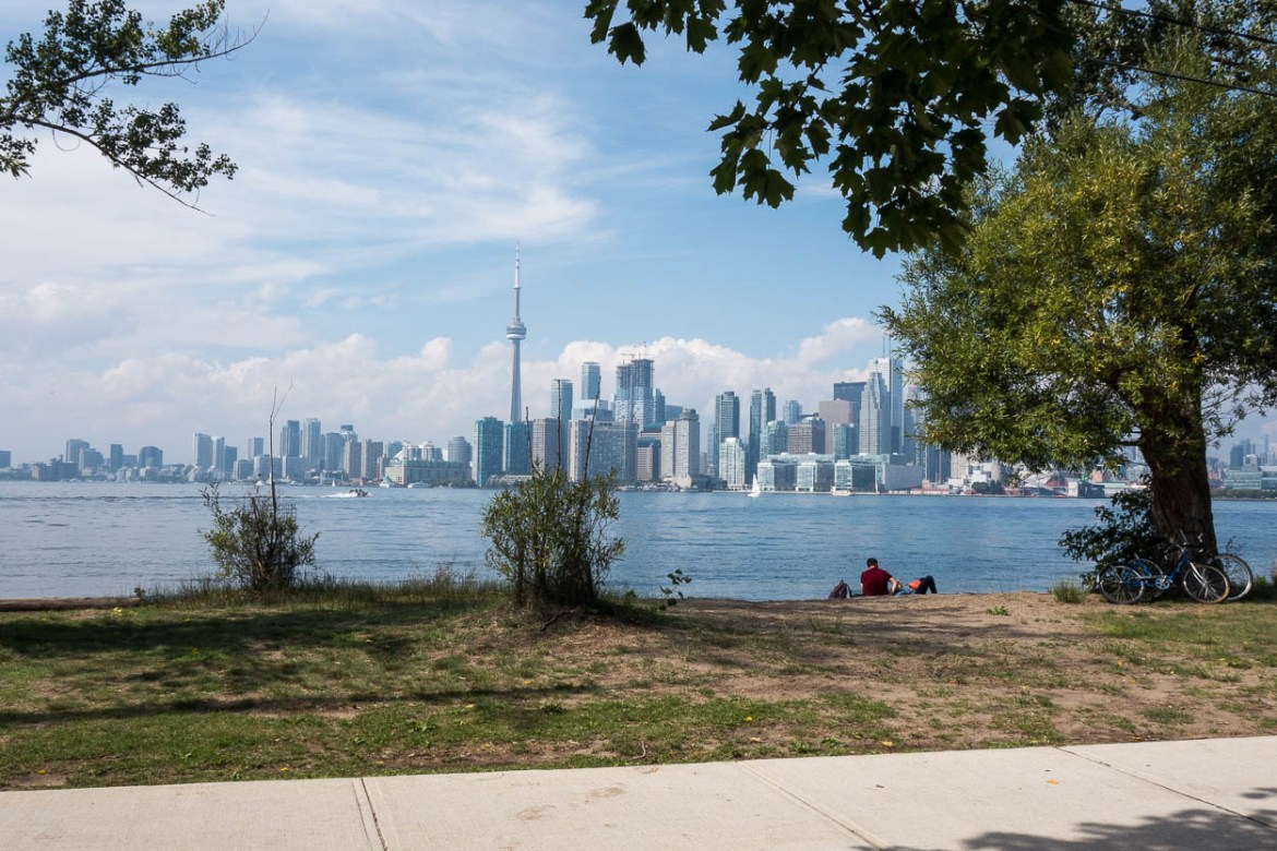 Couple cuddling on the shore of the Toronto Islands