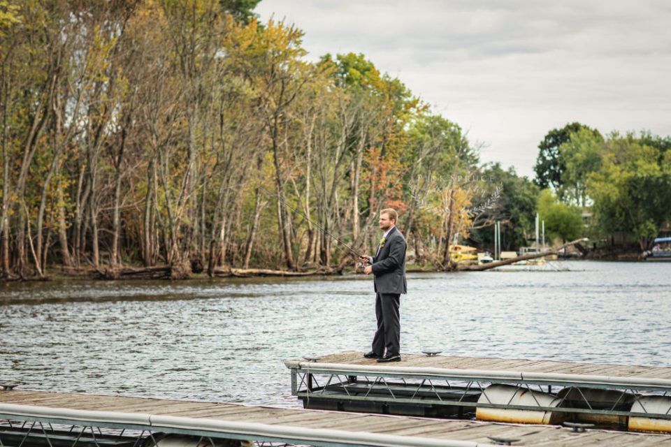 Fishing off the dock on wedding day · Celebrations on the River Wedding in La Crosse, WI