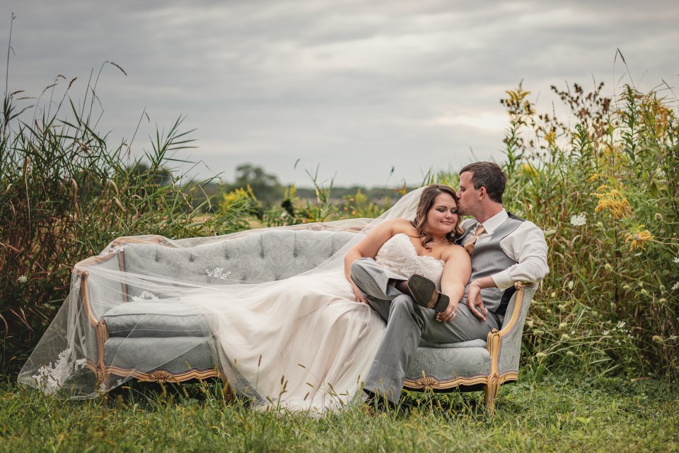 Wedding Day Photo on Vintage Loveseat.  The Greenhouse at Bittersweet Flower Market Wedding   Pink Spruce Photography   www.pinksprucephotography.com