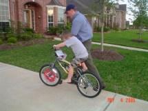 Boy Riding Bike Barefoot