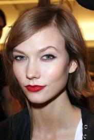 Red lips at Oscar de La Renta RTW 2013. Beauty prediction for Jennifer Lawrence