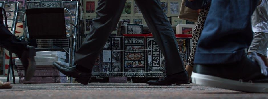 image of man's feet walking through alleyway