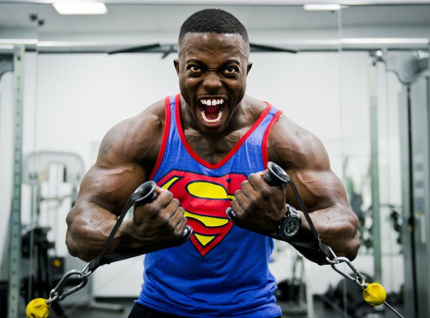 bodybuilder with superman shirt on